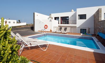 Photo for 5 bedroom Villa, sleeps 10 with Pool, Air Con, WiFi and Walk to Beach & Shops