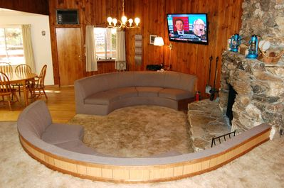 Living room with sunken circular couch