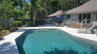 Large private pool and entertainment area, tiki bar, with fully fenced in yard.