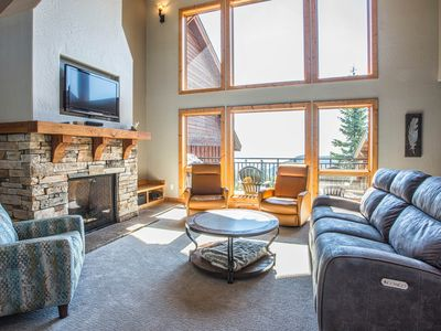 Photo for Schweitzer Mountain ski-in/ski-out townhome w/ private hot tub & lake view!