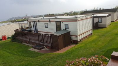 Photo for 4 Berth Holiday Caravan with stunning sea views 5☆rated with large outside deck