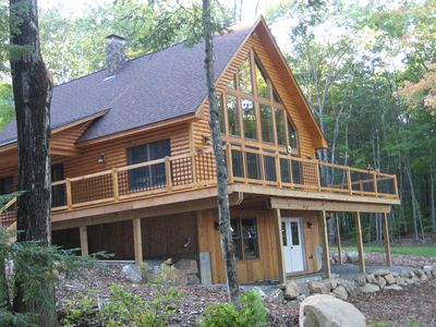 Photo for Beautiful waterfront log cabin on pristine Maine lake