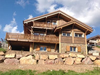 Photo for New chalet, 300 m from the slopes, lake view, sauna, outdoor swimming pool