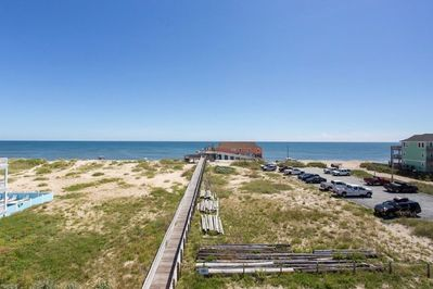 Oceanfront view with Easy Direct Beach Access via wooden walkway