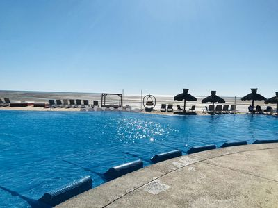 Photo for Spacious 2BR Condo w/ Ocean View and Resort Amenities