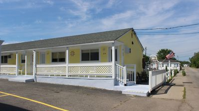 Photo for Center Location! 5 Minute walk to Pier and the Beach.  1 free parking spot!