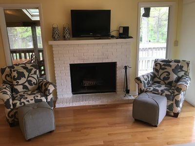 Beautiful family room with working fireplace overlooking upper decks!
