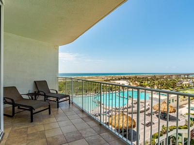 Photo for Caribe 2/2: Updated, super clean, spacious, gorgeous views of beach, bay, pools!
