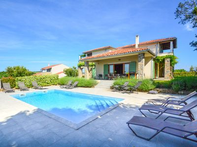 Photo for This 5-bedroom villa for up to 10 guests is located in Buje and has a private swimming pool, air-con
