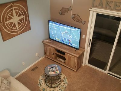 """Living area with 55"""" smart tv"""