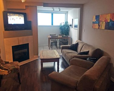Open plan living room & dining room with patio access and kitchen,