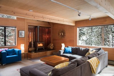 The open-plan living room/dining room with woodstove is the heart of the house