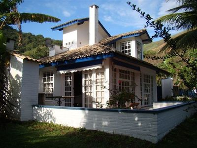 Photo for Guaecá house 80m from the beach, in condominium.