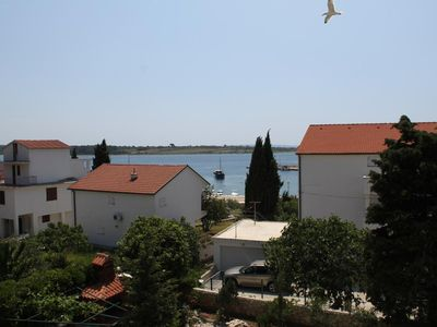 Photo for One bedroom apartment with balcony and sea view Novalja, Pag (A-6317-d)