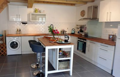 Make yourself at home in the well-equipped kitchen, + enjoy informal eating area