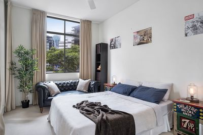 Spacious and private main bedroom is set on the right side of the apartment