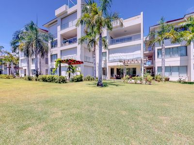 Photo for Modern golf-course-front apartment w/ shaded terrace & resort pool!