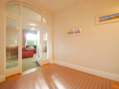 Photo for Water's Edge | Stunning Garden Apartment with Sea Views