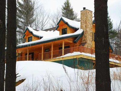 Winter snow on the Field and Stream Dream Cabin at Sterling Ridge Log Cabins.