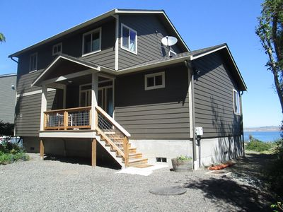 Front view of the house, street parking, to th Ocean in back.Covered front porch