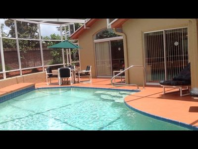 Private pool with screened enclosure solar heated
