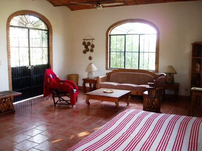 Living room with french doors opening up to a small
