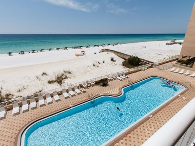 ISLANDER POOL - Our 80 foot heated swimming pool is beachside! The deck also holds ample space for basking in the warm Florida sun.