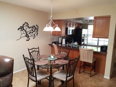 Dining area for 4 and bar counter with 2 chairs