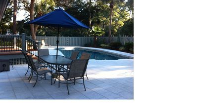 Backyard features newly refinished pool, expanded entertainment area, tiki hut
