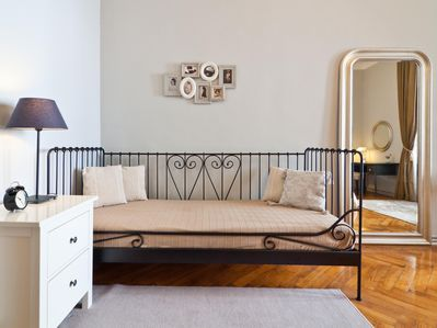Sonata: Single bed in the master bedroom; with a set of Madame d'Ora photos