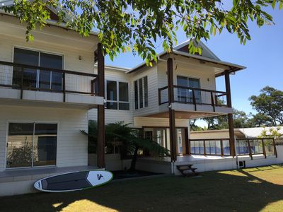 Photo for Beautiful family beach house with pool on the bay's best stretch of beach