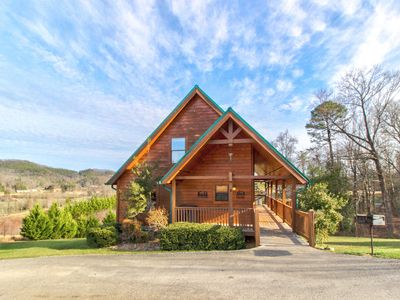 Photo for Picturesque family-friendly cabin w/ private hot tub, shared pool