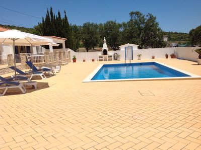 Patio area, sun beds, parasols, Stunning pool and built in BBQ.