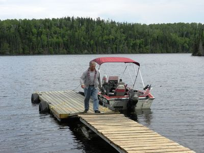 Photo for Woman River Boat In Outpost Fishing Camp