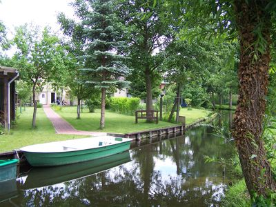 Photo for Modern, spacious apartment, close to town, quiet, Idyllic waterfront with boat.