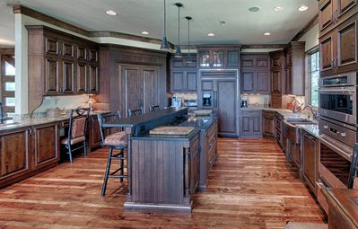 Fully Stocked Gourmet Kitchen with Island and Deck Area. Lots of Cupboards.
