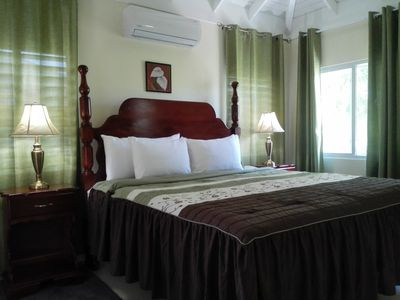 Master bedroom with king sized bed. AC throughout villa.
