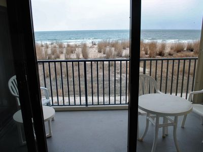 Photo for Cozy, yet spacious 2 bedroom oceanfront condo with free WiFi and a stunning view of the ocean located midtown just a few steps to the beach!