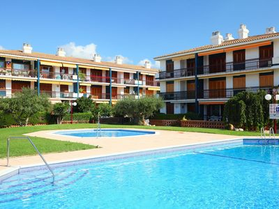 Photo for Lovely apartment for 4 guests with pool, A/C, TV and parking