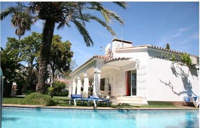 Photo for Exclusive Villa With its own heated Swimming Pool and Jacuzzi - Walk To Beach!