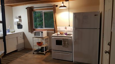 Spacious kitchen with full size fridge and stove