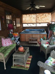 Enjoy the hot tub on the screened porch even if it's snowing or raining!