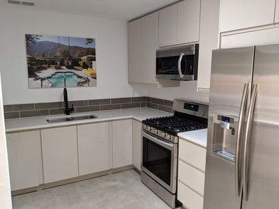 Photo for Bright Modern Condo with Yard, Feels Like a House