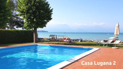 Photo for Renovated studio with garden and swimming pool in front of the Casa Lugana lake 2