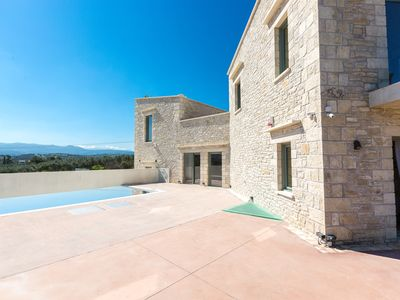 Photo for Brand new Villa with heated pool and country side views, close to sandy beaches!