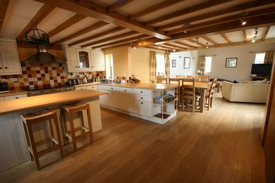 Kitchen, dining area and living room. Spacious and homely.