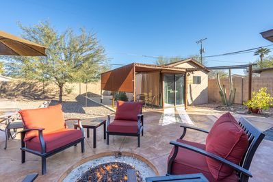 Patio - Enjoy a large shared patio with cushioned seating and an in-ground fire pit.