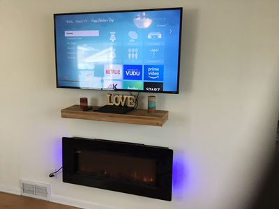 New Electric Fireplace, New 55 inch flat screen Smart TV. Blazing fast WIFI.