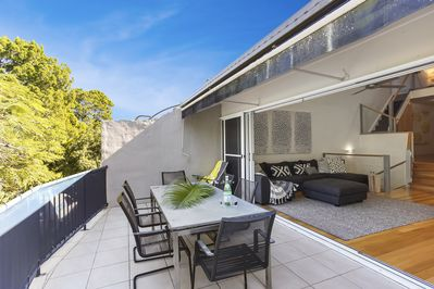Alfresco living.  You will love relaxing out on the large furnisghed balcony.
