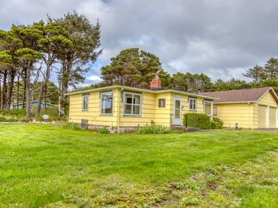 Photo for Ocean view cottage w/ deck, yard & firepit - walk to the beach, dogs welcome!